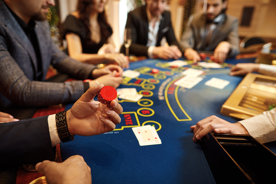 people playing poker at table